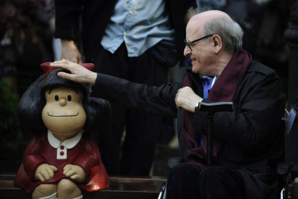 Cartoonist Joaquin Salvador Lavado, also known as Quino, touches a sculpture of his comic character Mafalda, during an opening ceremony of a park of San Francisco in Oviedo, northern Spain, October 23, 2014. Quino will be awarded with the 2014 Prince of Asturias Award for Communication and Humanities at a ceremony on Friday in the Asturian capital. The Prince of Asturias Awards have been held annually since 1981 to reward scientific, technical, cultural, social and humanitarian work done by individuals, teams and institutions. REUTERS/Eloy Alonso (SPAIN - Tags: SOCIETY MEDIA ENTERTAINMENT)