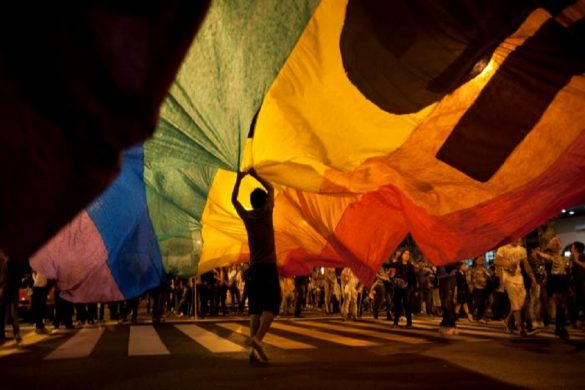 Participants hold up a rainbow banner at Argentina's annual gay pride parade in Buenos Aires, Argentina, Saturday, Nov. 10, 2012. Argentina has improved rights for sexual minorities over the last years, becoming the first country in Latin America to legalize same-sex marriage, and this year, the Congress approved Argentina's gender identity law, granting people the right to change their legal and physical gender identity simply because they want to, without having to undergo judicial, psychiatric and medical procedures beforehand. (AP Photo/Natacha Pisarenko)