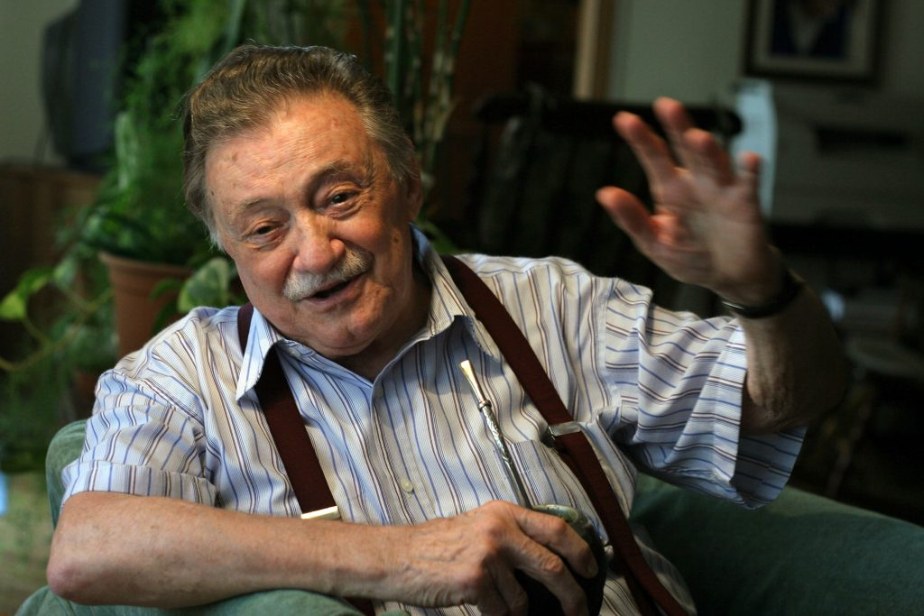 "FILE - Uruguayan writer Mario Benedetti gestures during an interview at his home in Montevideo on January 7, 2007. Benedetti died on May 17, 2009 at the age of 88 as a consequence of an intestinal disease. Born in 1920, Benedetti has written tales, poems, essays, theatre and novels and is one of Latin America's best known writers. The Argentine film based on his novel ""La Tregua"" (The Truce) was nominated for an Oscar in 1974 for Best Foreign Language Film, while singers such as Spanish Joan Manuel Serrat and Uruguayan Daniel Viglietti have sung his poems. AFP PHOTO/PABLO BIELLI"
